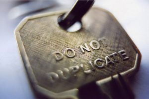 "The photo is a close-up of a key that says ""DO NOT DUPLICATE"" in capital letters."