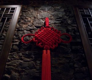 A red Chinese knotting as decorative art hanging in the wall