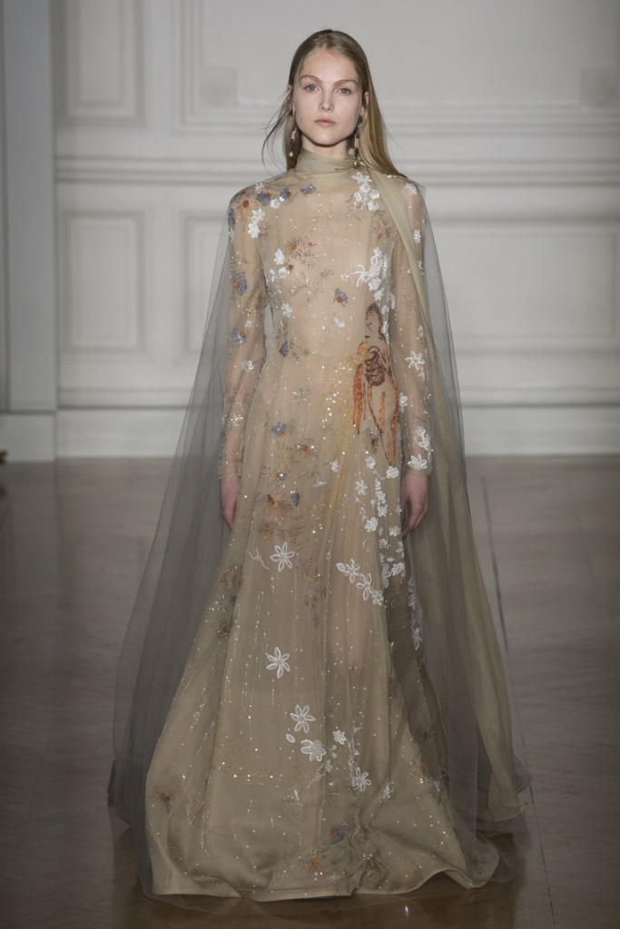 Look 47 of Valentino's Spring '17 Couture. A drapy, light beige dress with embroidered flowers.
