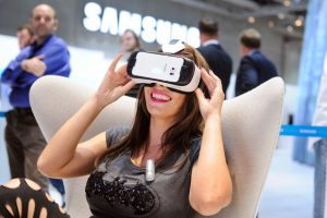 """Berlin, Messe. """"A woman uses a Samsung Gear VR headset at the IFA consumer electronics show in Berlin on Sept. 4, 2015"""" Photograph. CIO. September 16, 2015"""