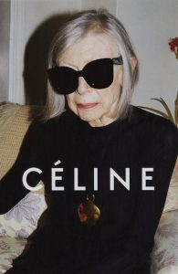 80-year-old Joan Didion posing on couch in sunglasses for Céline campaign