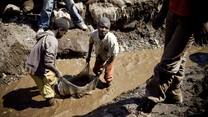 Children at work in a mine in Kamatanda, in the Katanga region of DR Congo, on July 9, 2010