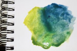 Yellow and blue watercolour paint diffusion.