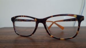 Brown and yellow patterned glasses on a wood counter